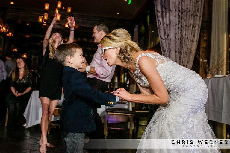 Bride dancing with the ring bearer at West Shore Cafe.