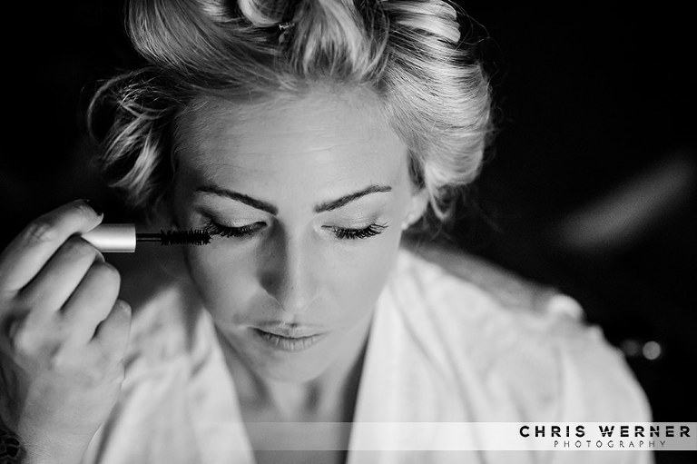 Black and white photo of a bride getting ready by a Reno wedding photographer
