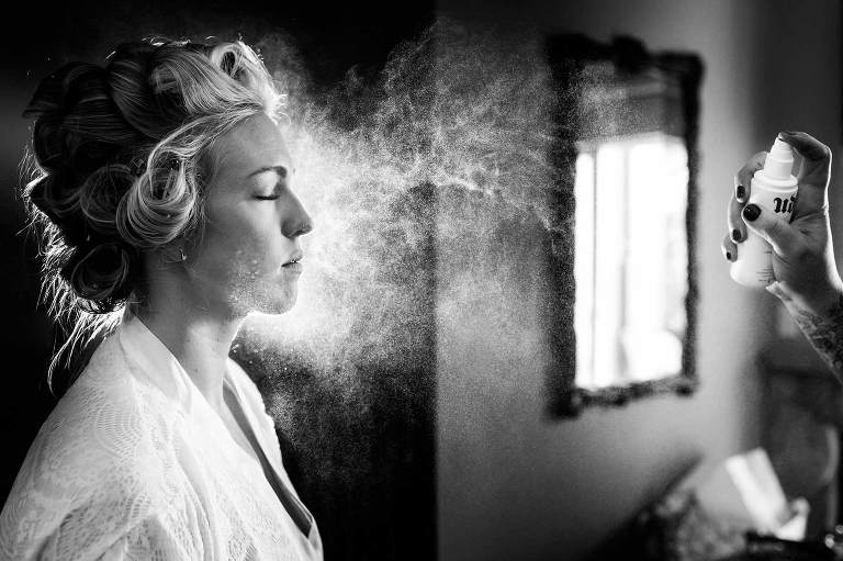 Bride in a mist of hairspray, getting ready before her Reno wedding ceremony.