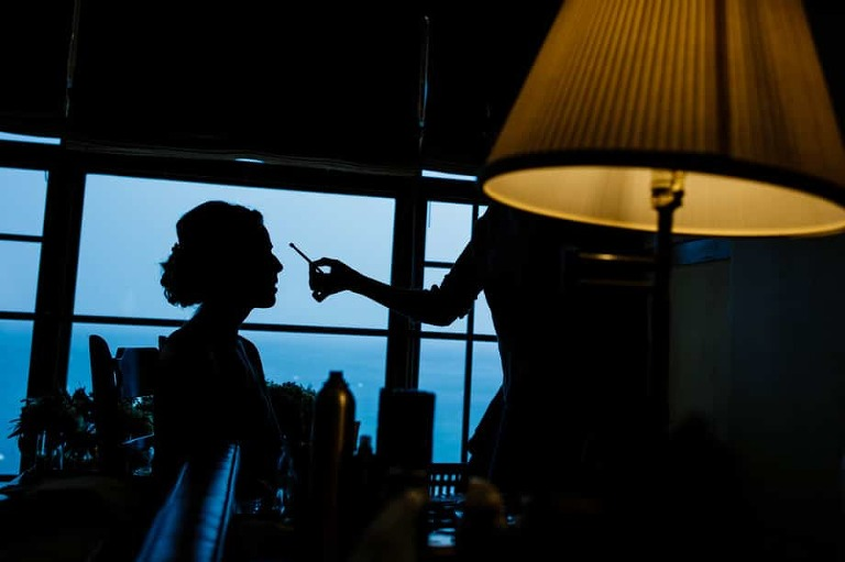 Winter Lake Tahoe wedding photo of bride getting ready.