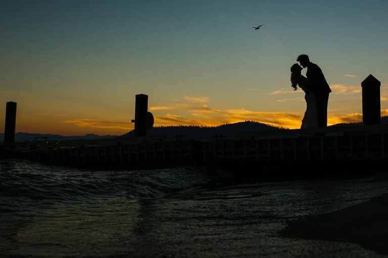 Lake Tahoe Hyatt wedding photo of bride and groom on the pier at sunset.