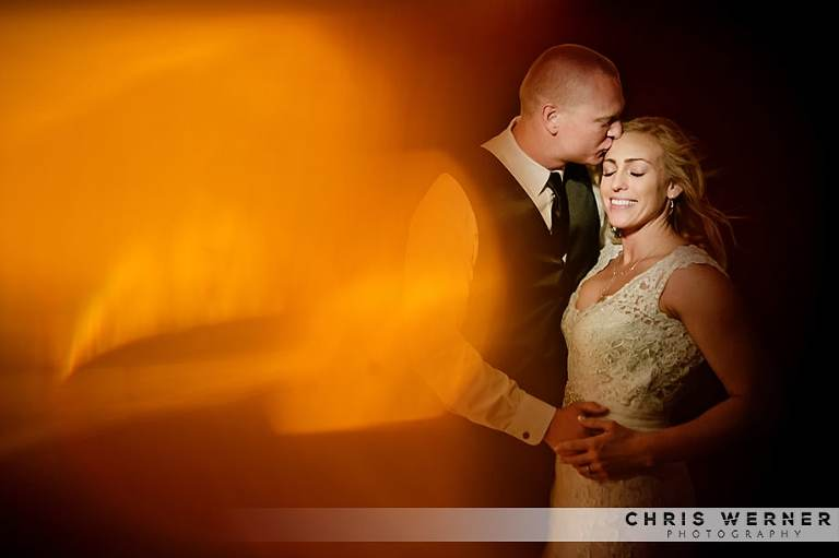 Artistic photo of bride and groom by a Reno wedding photographer.
