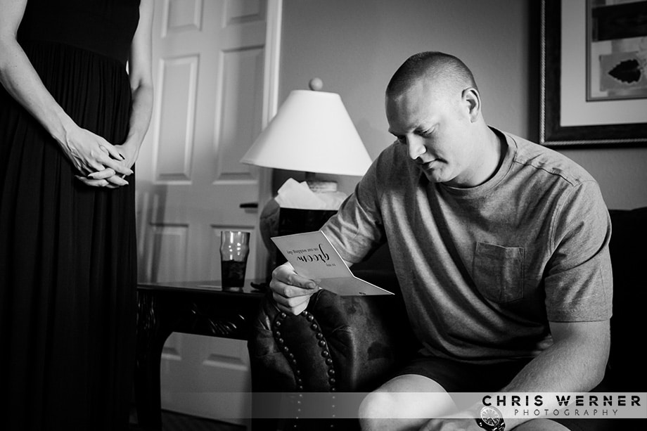 Groom reading a card from his bride. Photograph by a Reno wedding photographer