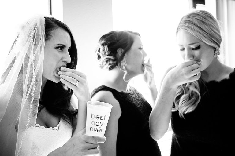 Lake Tahoe bride and bridesmaids eat limes after a tequila shot.