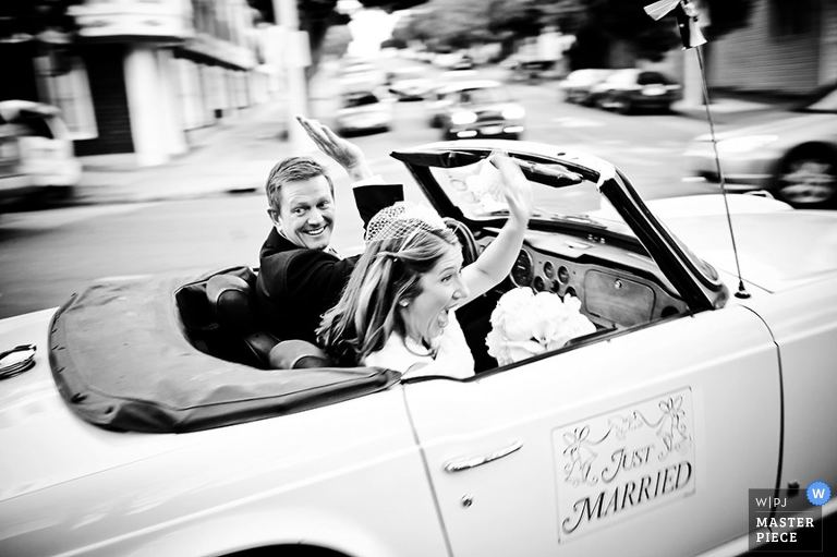 A getaway car for the bride and groom is a traditional way for the newly-married couple to leave the ceremony.