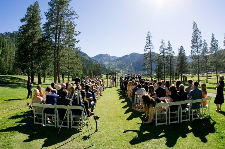An outdoor Resort at Squaw Creek wedding ceremony has views of the valley, meadows, and mountains of Lake Tahoe.