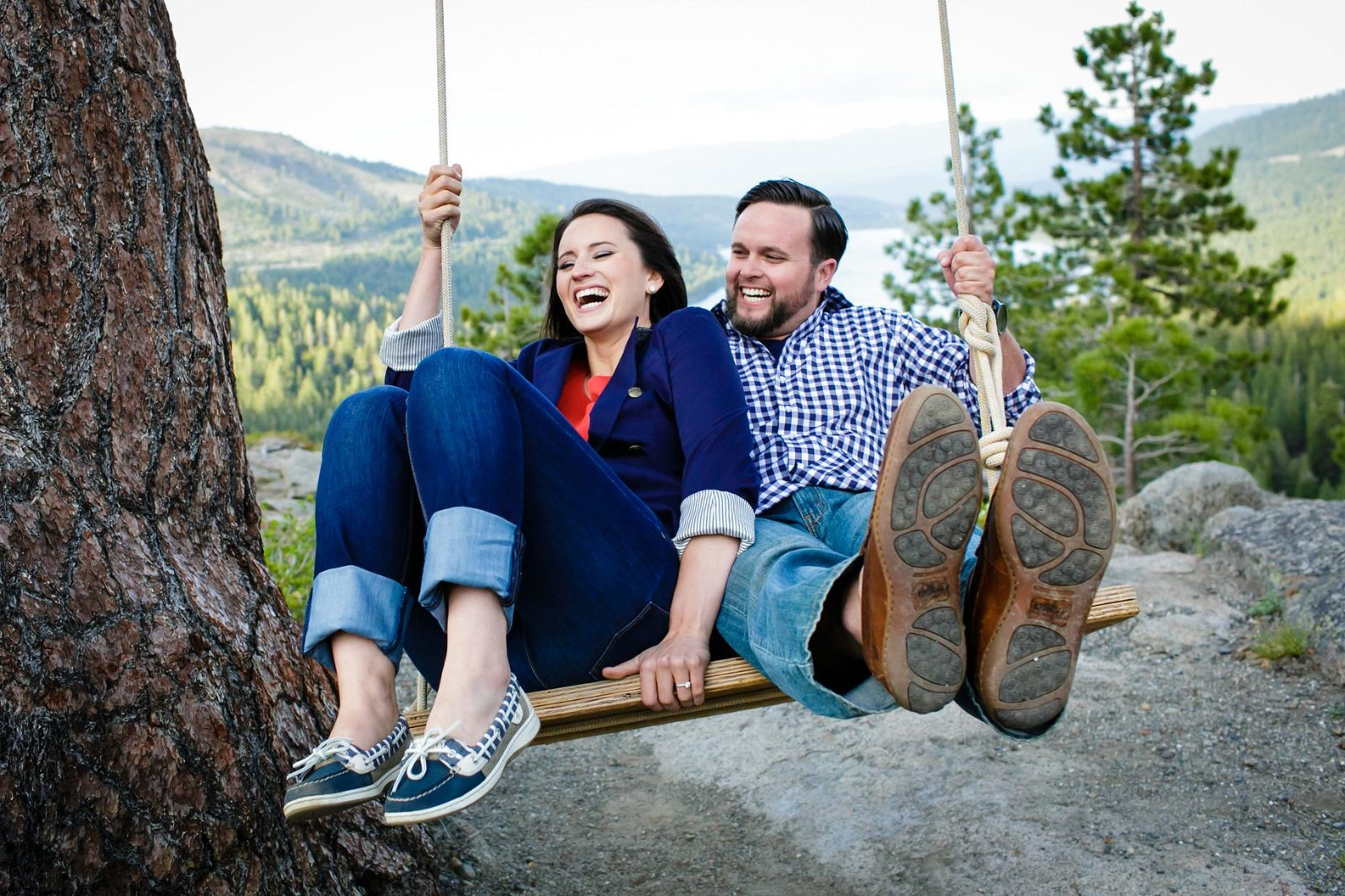 A swing hanging from the branch of a pine tree is a fun place to stop for a few Lake Tahoe engagement photos.